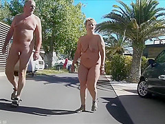 Mature couples walk around the nudist resort completely naked