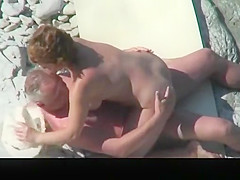 Mature nudist couple spied in rocky beach